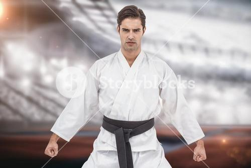 Composite image of portrait of serious karate player