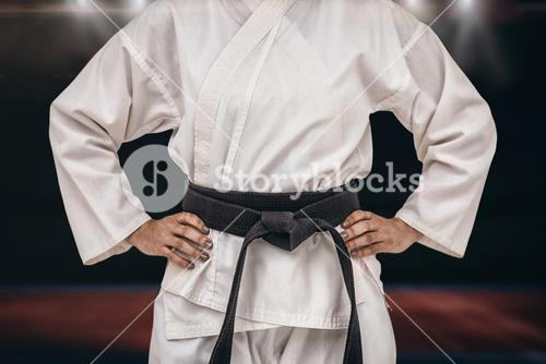 Composite image of female fighter standing with hand on hip