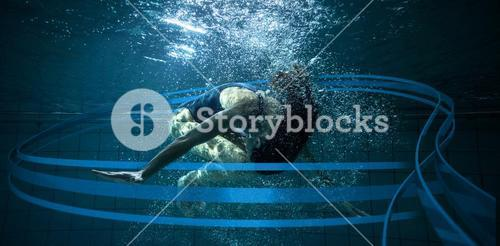 Composite image of athletic swimmer doing a somersault underwater