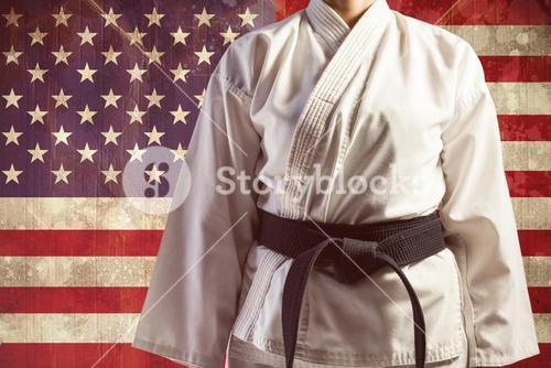 Composite image of mid section of karate player