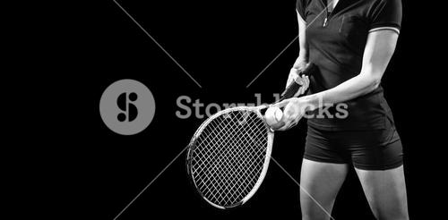 Tennis player holding a racquet ready to serve