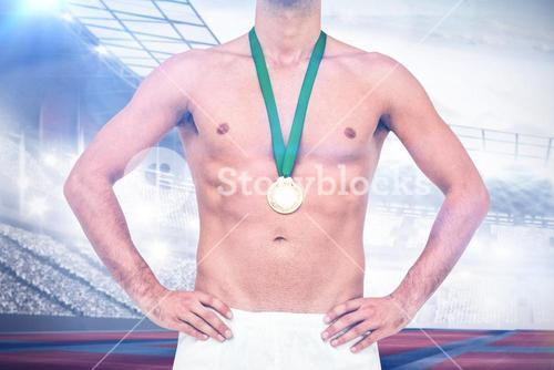 Composite image of athlete posing with gold medal on white background