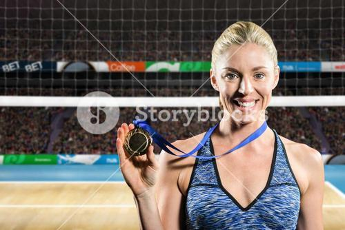 Composite image of female athlete posing with gold medal around his neck
