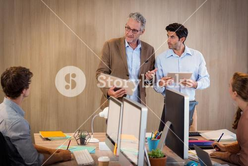 Businessman giving a presentation to colleagues
