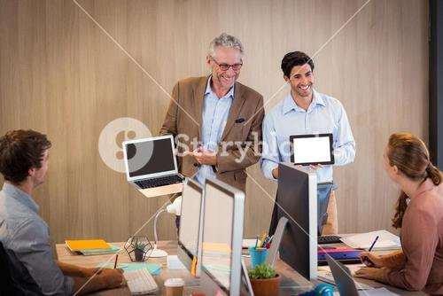 Businessman giving a presentation with colleague