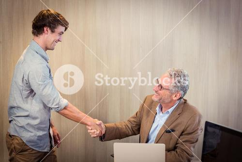 Businessman shaking hands with a coworker