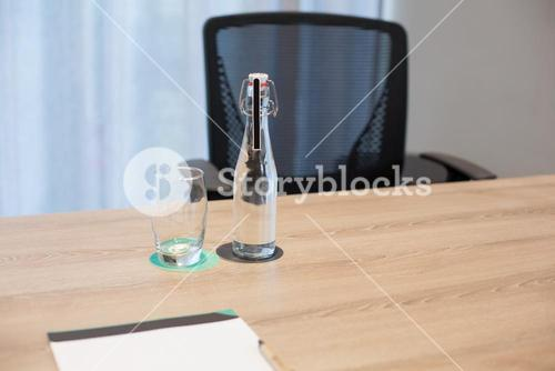 Empty glass and bottle