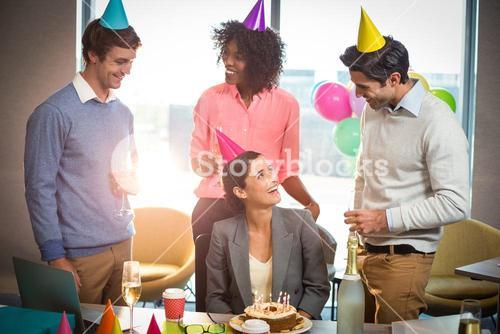 Business people celebrating birthday