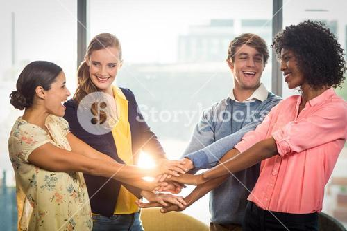 Business people forming hands stack