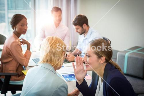 Business people gossiping during meeting