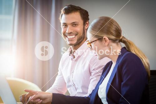 Businesswoman interacting with a colleague