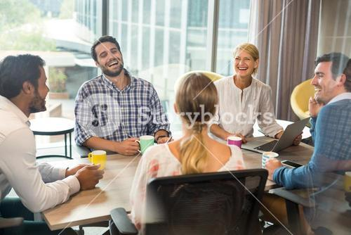 Business people holding coffee mug during a meeting