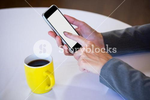 Woman taking a picture of coffee