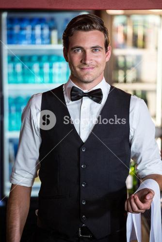Bartender with napkin draped on his hand