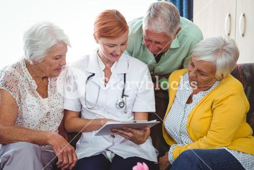 Retired person looking at a notebook