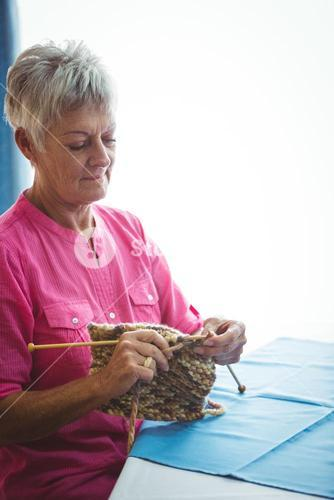 Retired woman doing some knitting