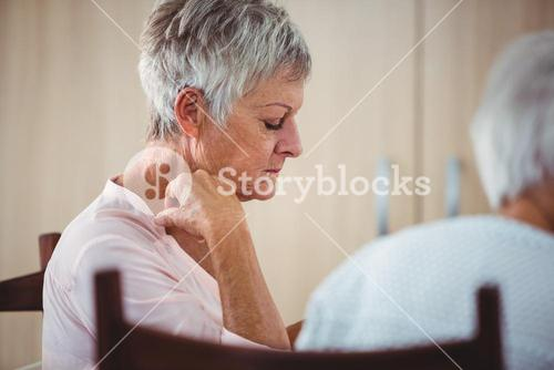 Side of a senior looking sad woman