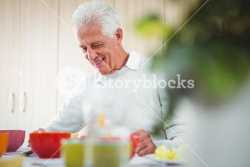 Senior man smiling during the lunch