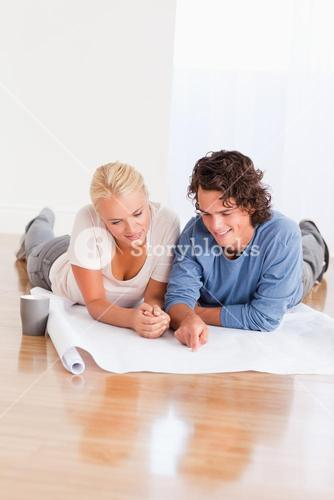 Portrait of a lovely couple organizing their new home