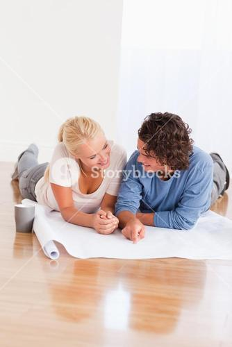 Portrait of a smiling couple organizing their new home