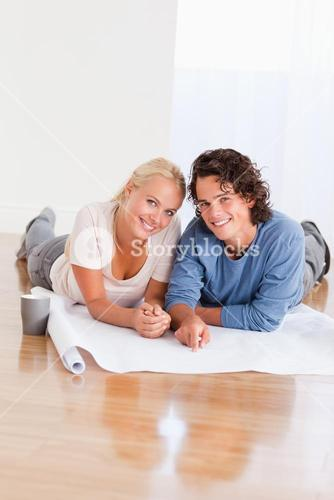 Portrait of a happy couple organizing their new home