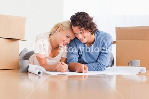 Happy couple organizing their new home