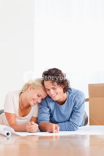 Portrait of an in love couple organizing their new home