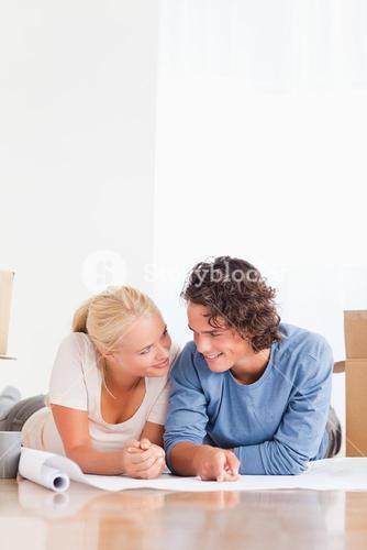 Portrait of an in love couple organizing their future home