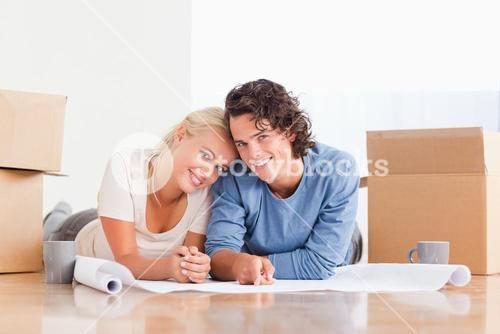 Couple organizing their future home