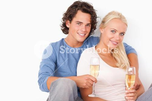 Couple with glasses of sparkling wine