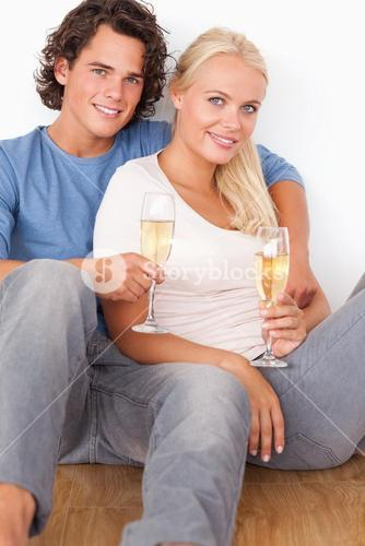 Portrait of a couple with glasses of sparkling wine