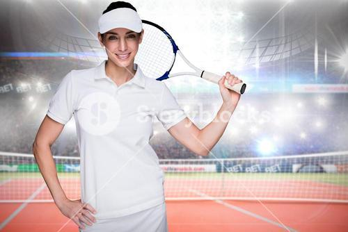 Composite image of sportswoman posing with a tennis racket