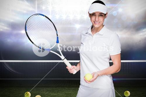 Female athlete posing with a tennis racket