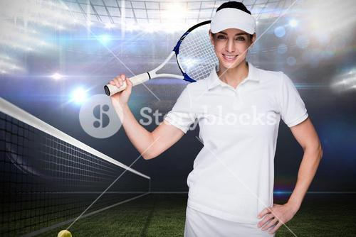 Sportswoman posing with her tennis racket