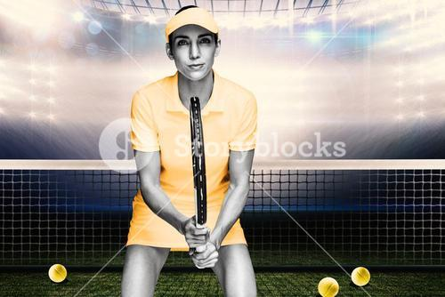 Composite image of female athlete waiting a tennis ball
