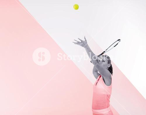 Athlete serving with her tennis racket