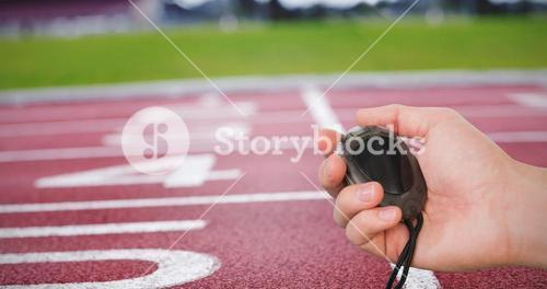 Close up of coach is holding a stopwatch