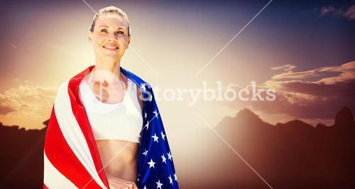 Portrait of american sportswoman is smiling  against composite image of landscape