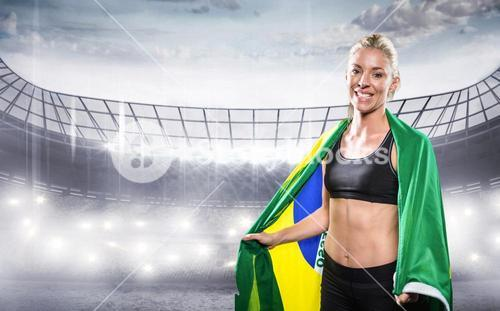 Composite image of athlete with brazilian flag wrapped around his body