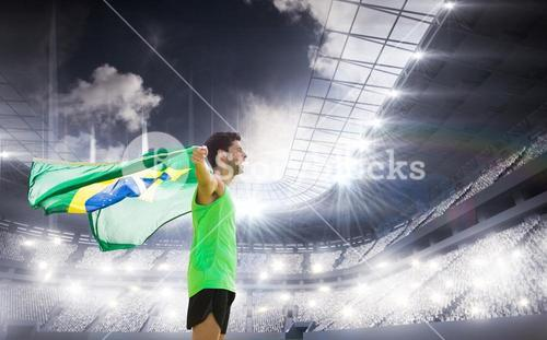 Composite image of profile view of brazilian sportsman is holding a flag