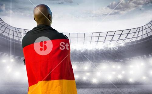 Composite image of man wearing German flag