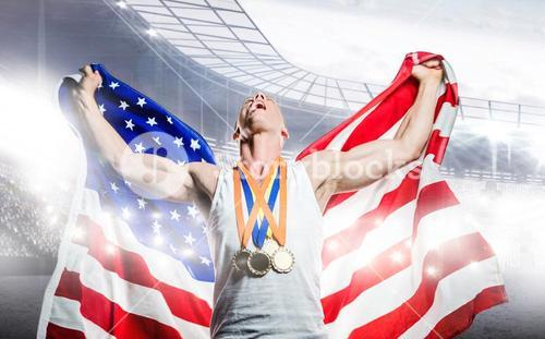 Composite image of athlete posing with American flag and gold medals after victory