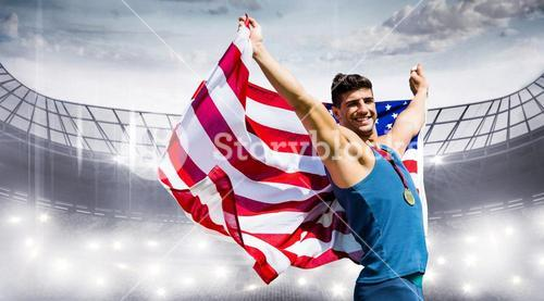 Composite image of sportsman celebrating his victory with American flag and medal