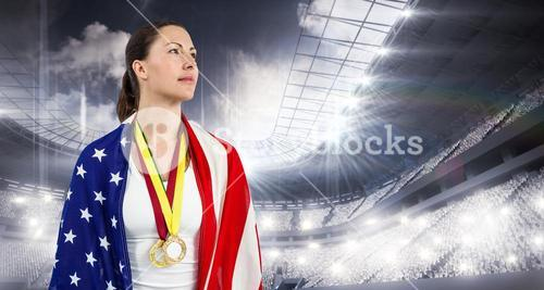 Composite image of athlete looking away with american flag and gold medals around his neck