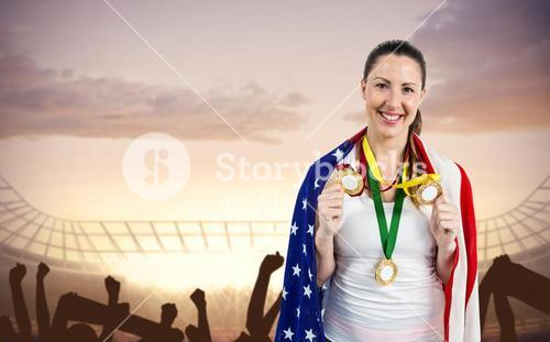 Athlete posing with gold medals after victory