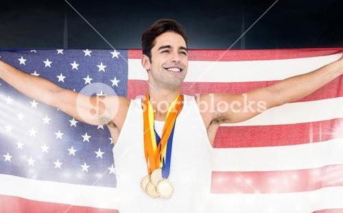 Composite image of athlete posing with gold medals and american flag after victory