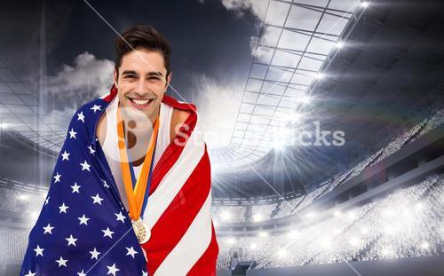 Composite image of athlete holding gold medals and american flag
