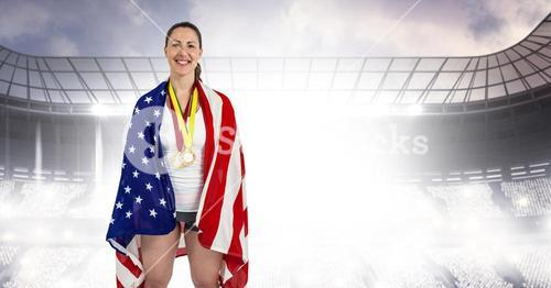 Composite image of athlete posing with american flag and gold medals around her neck