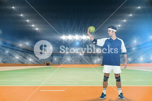 Composite image of sportsman posing with ball on white background