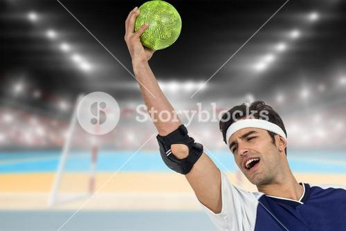Composite image of sportsman holding a ball on white background
